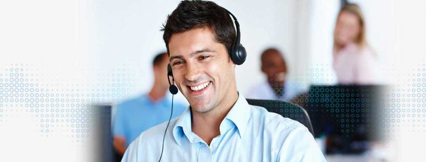 a guy giving technical support on call with a smile